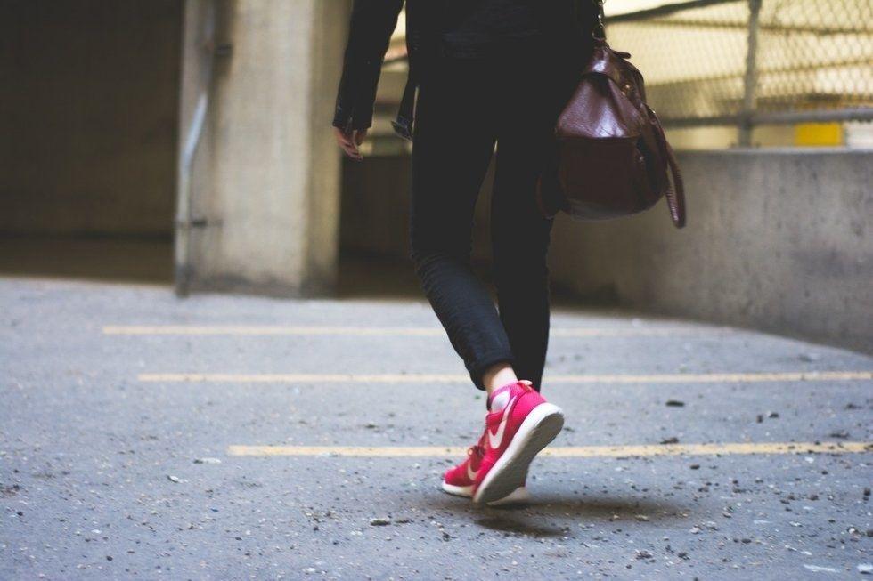 woman walking alone in parking garage