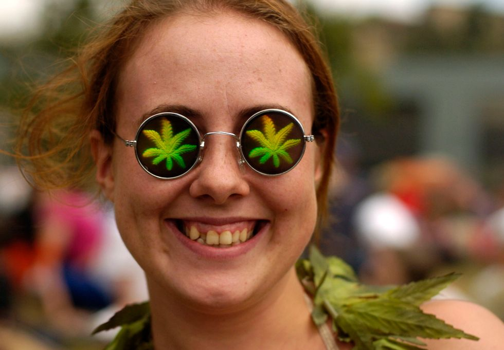 Girl with psychedelic weed glasses.