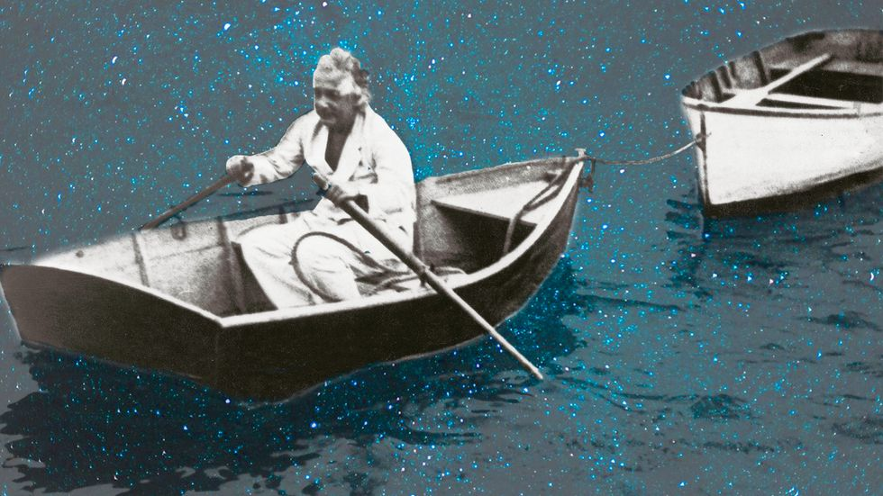 Albert Einstein in a rowing boat circa 1930. (Photo by Imagno/Getty Images)
