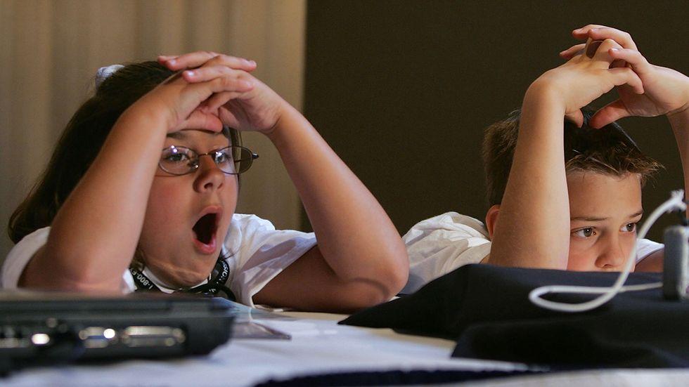 School kids yawning (Photo by Joe Raedle/Getty Images).