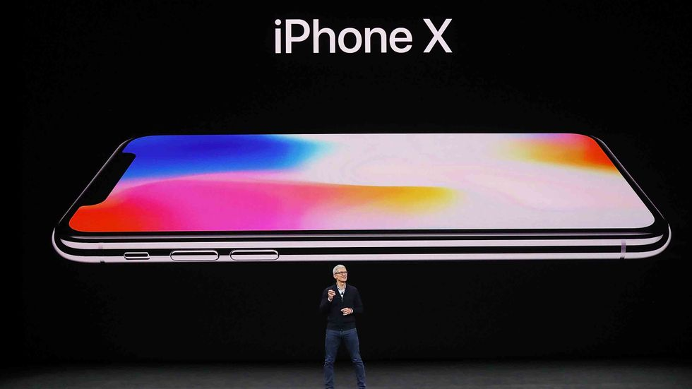 CUPERTINO, CA - SEPTEMBER 12: Apple CEO Tim Cook announces the new iPhone X during an Apple special event at the Steve Jobs Theatre on the Apple Park campus on September 12, 2017 in Cupertino, California. (Photo by Justin Sullivan/Getty Images)