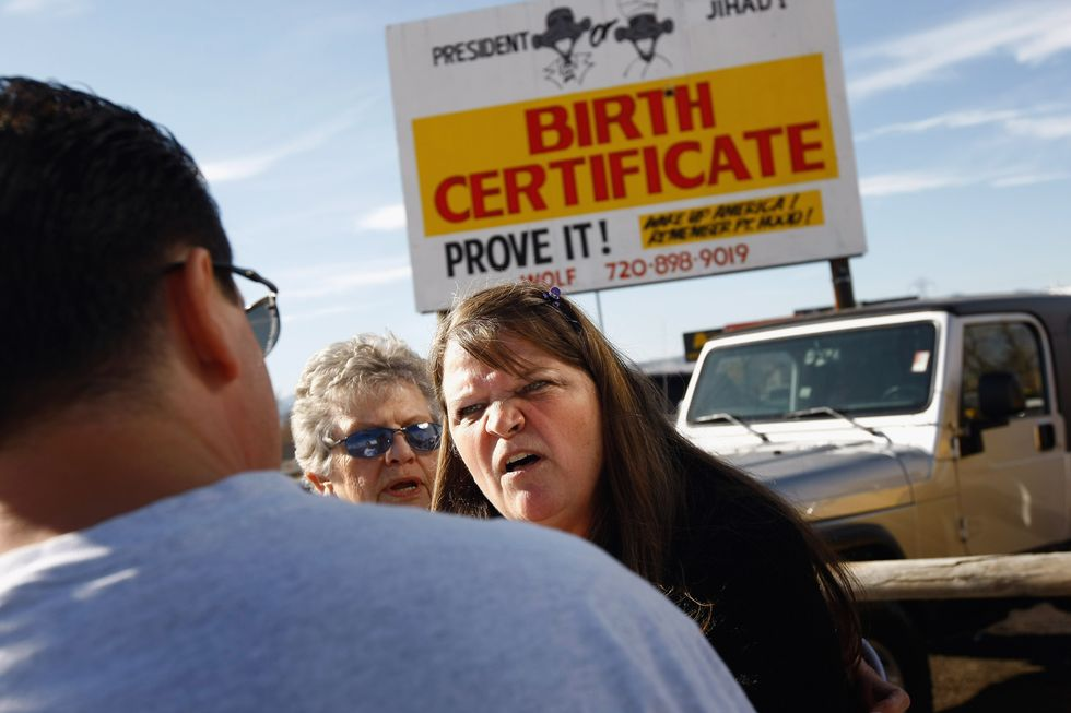 Argument in front of birther billboard.