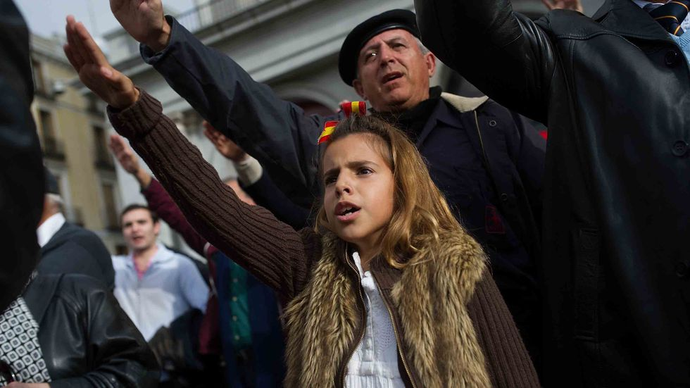 A young girl gives the fascist salute during the 39th anniversary of the death of Spanish dictator General Francisco Franco at Plaza Oriente square on November 23, 2014 in Madrid, Spain. (Denis Doyle/Getty Images)