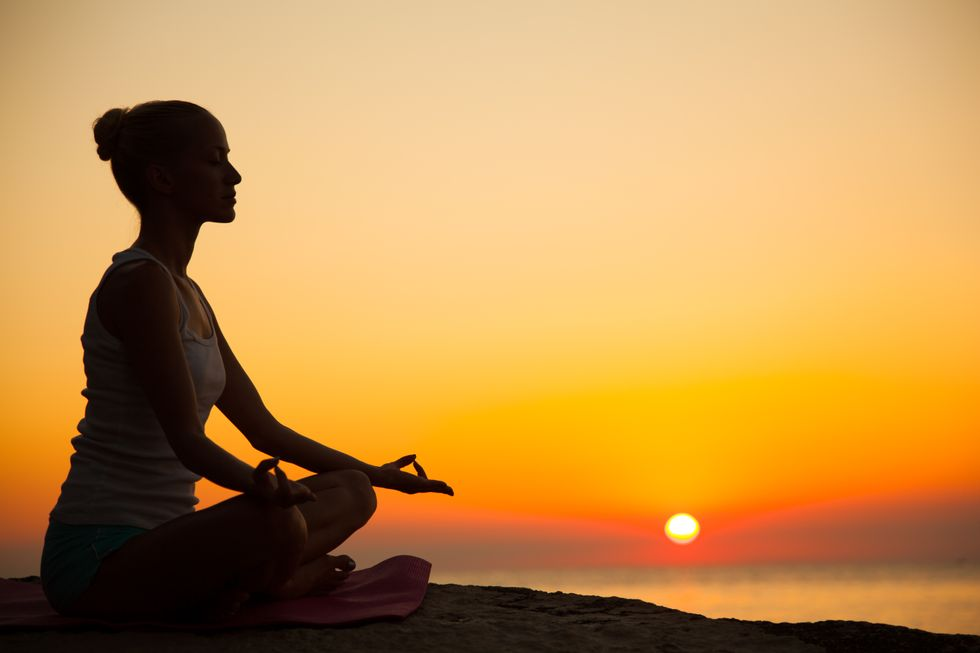 Meditating woman.