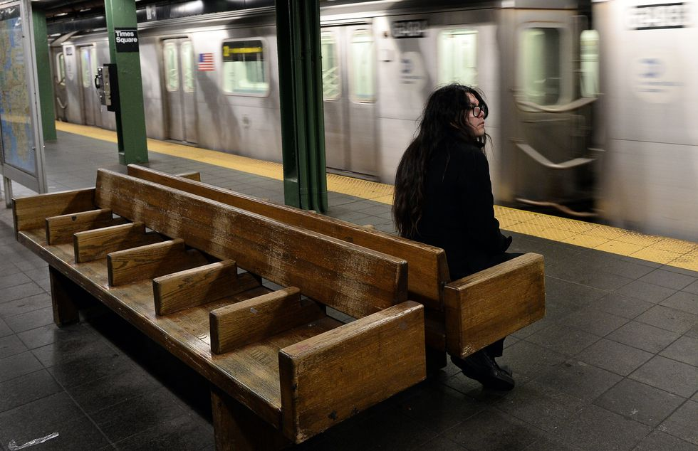 Lonely girl waiting for the subway.