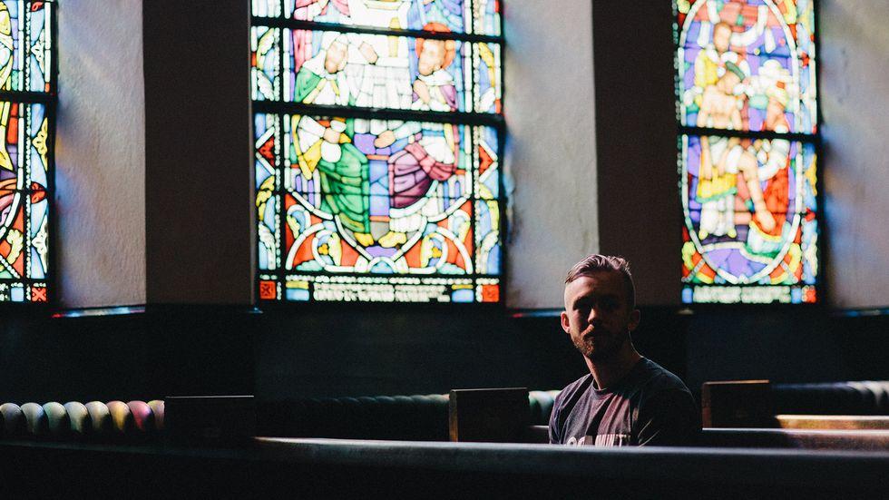 At church alone. Photo by Karl Fredrickson on Unsplash.