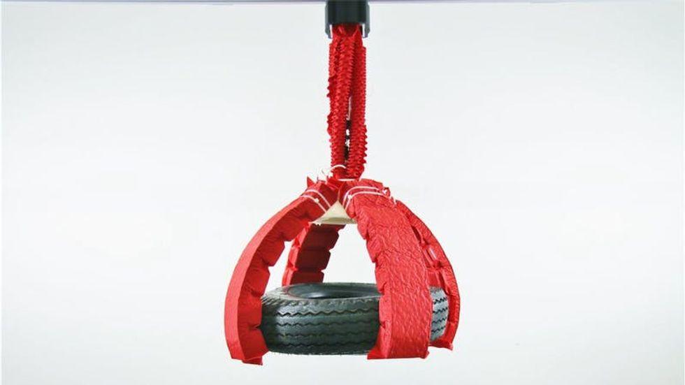Soft robot lifting a tire.