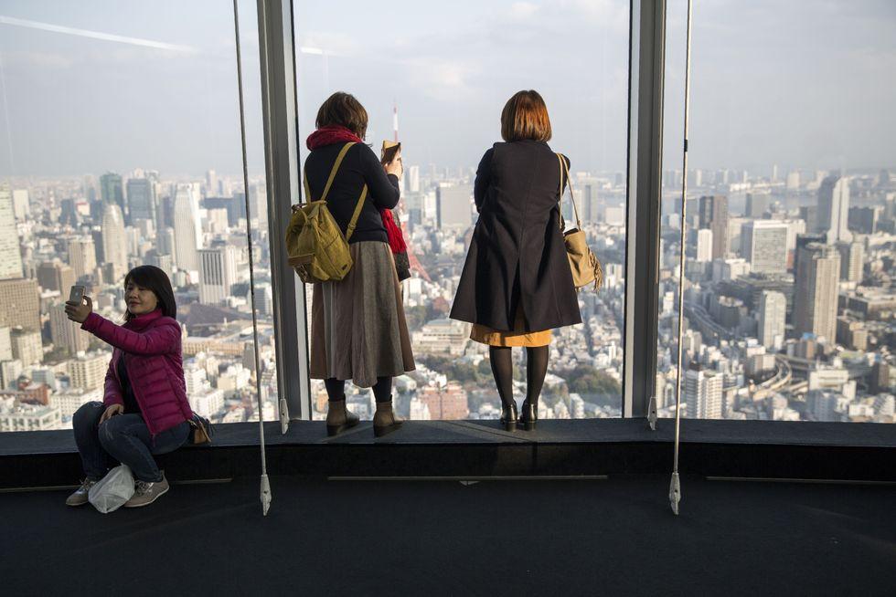 Visitors inside the Tokyo Metropolitan Government Building.