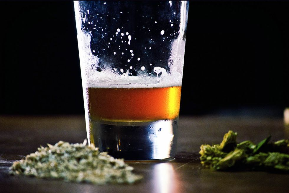 Close-Up Of Beer And Cannabis On Table (Getty Images)