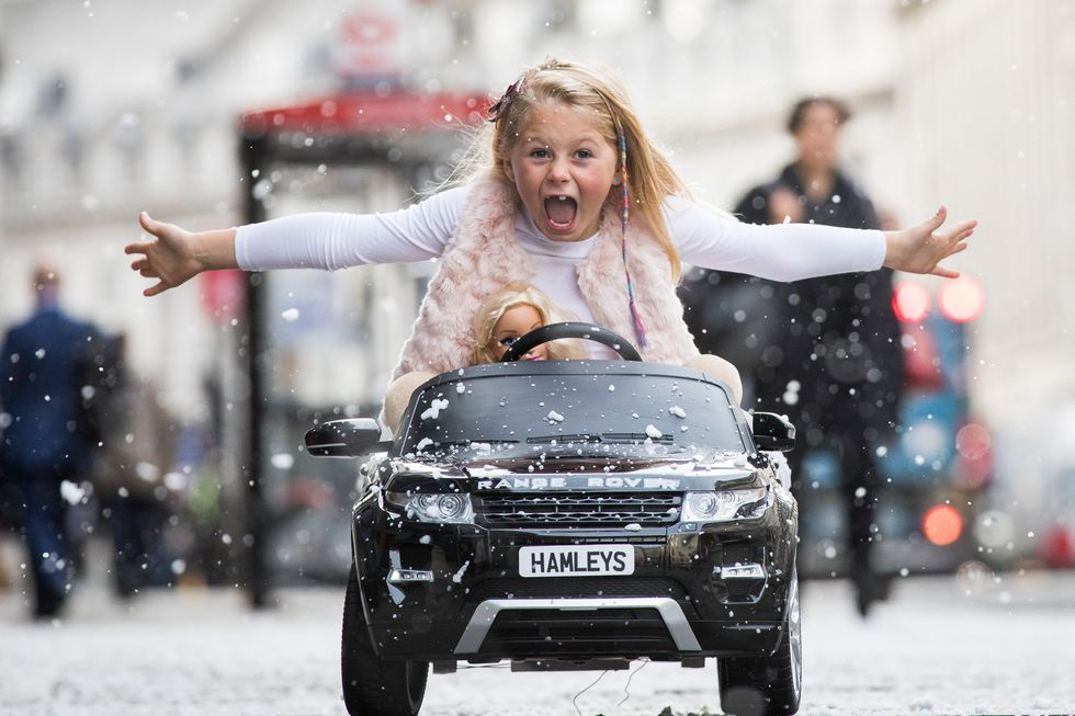 Girl in a toy car. Credit: Getty Images.