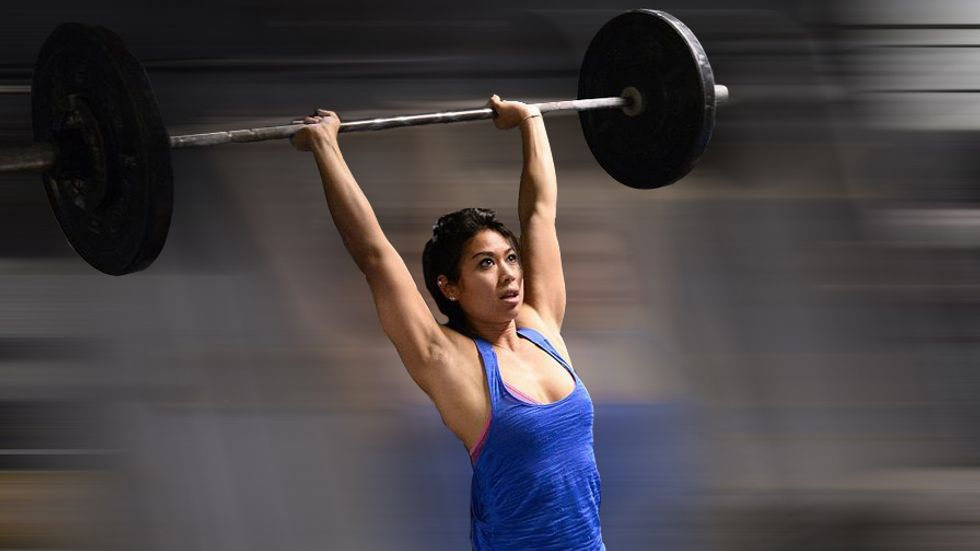 A woman lifts weight during a crossfit training in a gym in Paris. (Photo by Bertrand Guay/AFP/Getty Images)