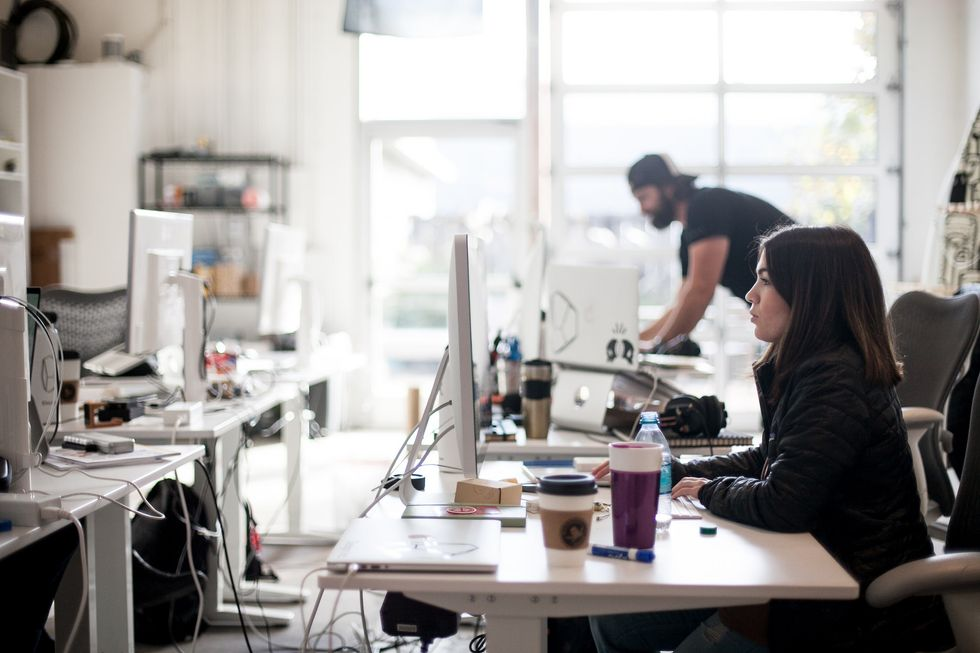 Two people in a modern office.