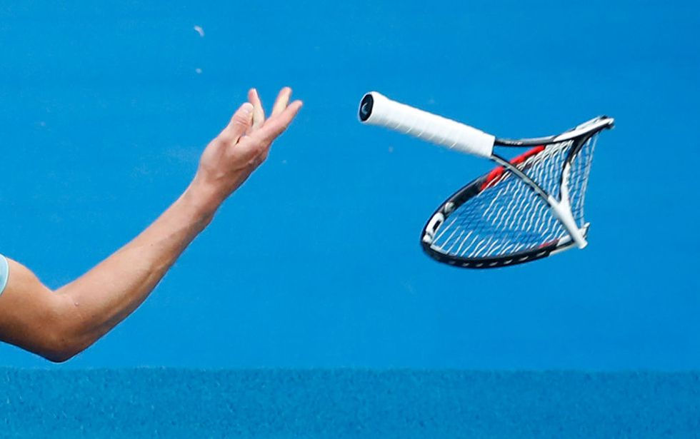 Alexander Zverev throws the racquet he smashed in frustration in the fifth set of his third-round match against Hyeon Chung of Korea on day six of the 2018 Australian Open at Melbourne Park. (Photo by Scott Barbour/Getty Images)