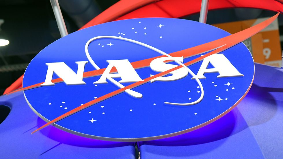 LAS VEGAS, NV - JANUARY 11: The NASA logo is displayed at the agency's booth during CES 2018 at the Las Vegas Convention Center on January 11, 2018 in Las Vegas, Nevada. CES, the world's largest annual consumer technology trade show, runs through January