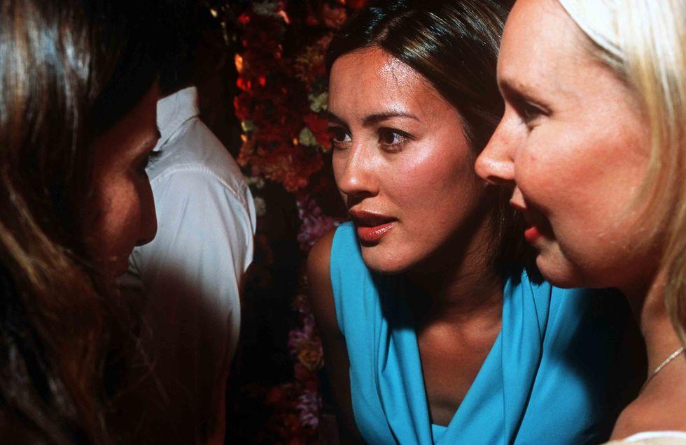 Three girls seemingly keen to exchange gossip.