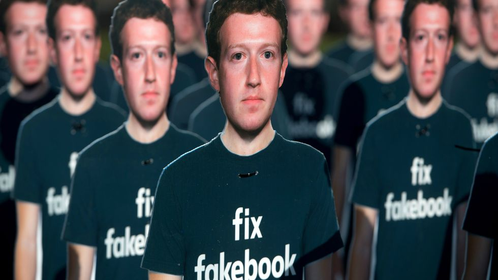 One hundred cardboard cutouts of Facebook founder and CEO Mark Zuckerberg stand outside the US Capitol in Washington, DC, April 10, 2018. (Photo: Saul Loeb/Getty)