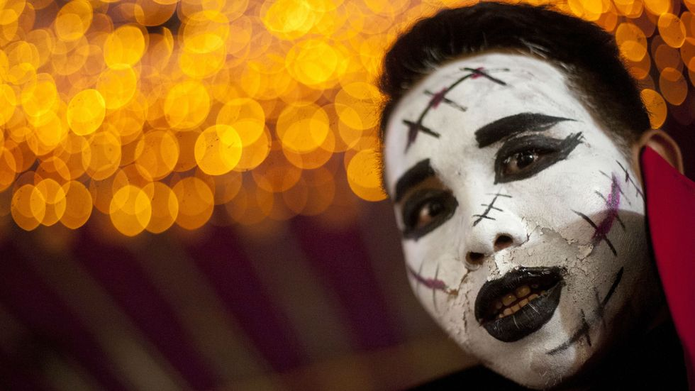 A man with costume make up looks on at a Halloween party in Yangon on October 31, 2014. Halloween, a contraction of All Hallows' Eve, is celebrated on the last day of October before All Saints Day. (Photo: Ye Aung Thu/AFP/Getty Images)