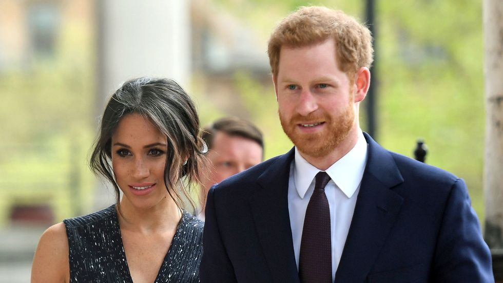 Britain's Prince Harry (R) and his US fiancee Meghan Markle arrive to attend a memorial service at St Martin-in-the-Fields in Trafalgar Square in London. (Photo: VICTORIA JONES/AFP/Getty Images)