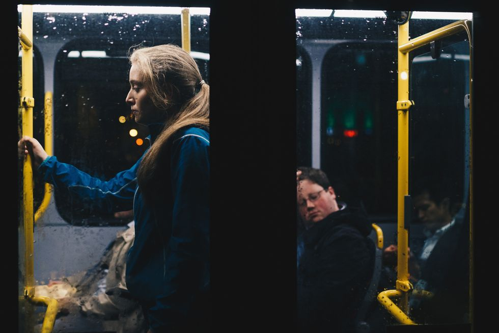 https://www.pexels.com/photo/photo-of-a-woman-standing-inside-bus-808700/
