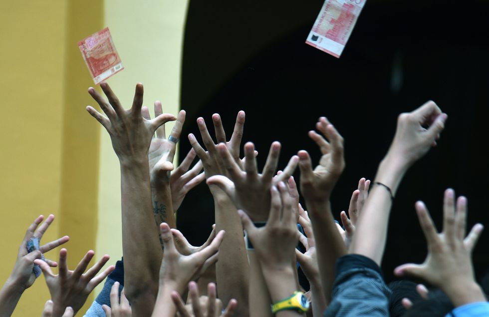 People jumping up into the air to catch money.