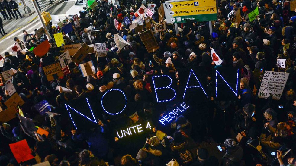 Protestors rally during a demonstration against the Muslim immigration ban at John F. Kennedy International Airport on January 28, 2017 in New York City. (Photo by Stephanie Keith/Getty Images)