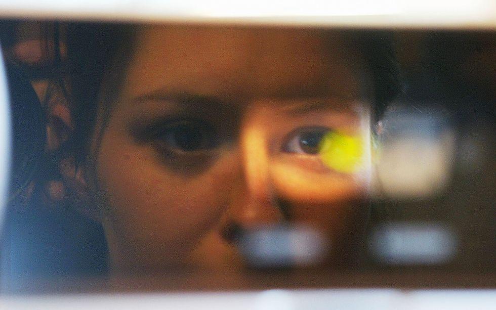 Woman undergoing a retinal scan.