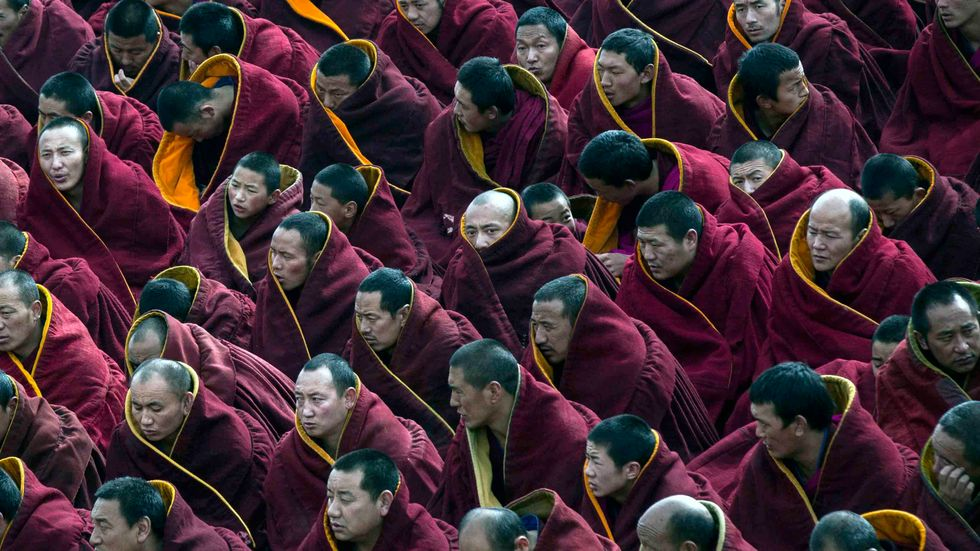 Tibetan Buddhist monks take part in a special prayer during Monlam or the Great Prayer rituals at the Labrang Monastery, Xiahe County, Amdo, Tibetan Autonomous Prefecture, Gansu Province, China. (Photo by Kevin Frayer/Getty Images)
