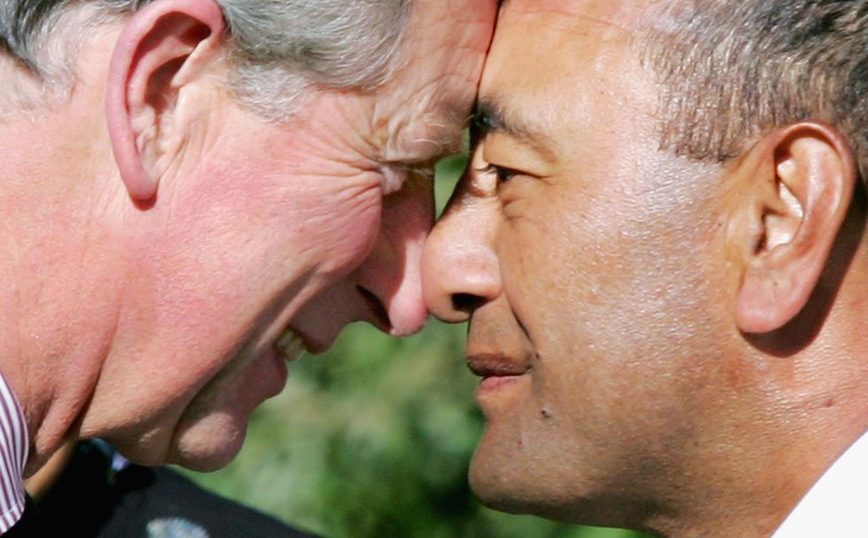 Narrow vs. wide nostrils on display as Britain's Prince Charles performs a traditional Maori 'hongi', a greeting where two people press noses, with Lieutenant Donald Ripia, of the Royal New Zealand Navy.