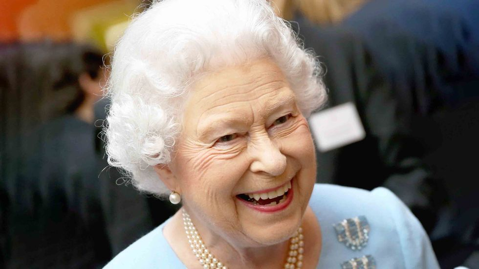 Queen Elizabeth II smiles as she attends a reception for the Queen's Anniversary Prizes for Higher and Further Education at Buckingham Palace on February 27, 2014 in London, England. (Chris Jackson/Getty Images)