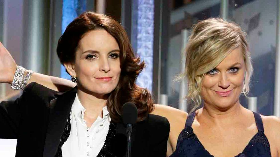 Hosts Tina Fey and Amy Poehler speak onstage during the 72nd Annual Golden Globe Awards at The Beverly Hilton Hotel on January 11, 2015 in Beverly Hills, California. (Paul Drinkwater/NBCUniversal via Getty Images)