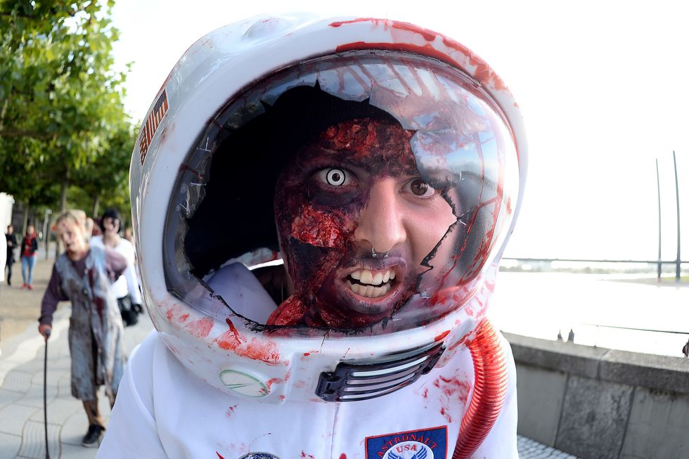 man in zombie spaceman outfit