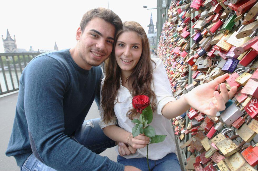 Cute couple has their love lock on a bridge.