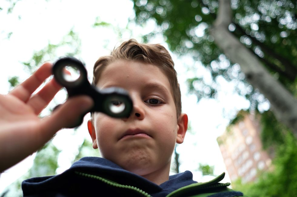 Little boy with a fidget spinner.