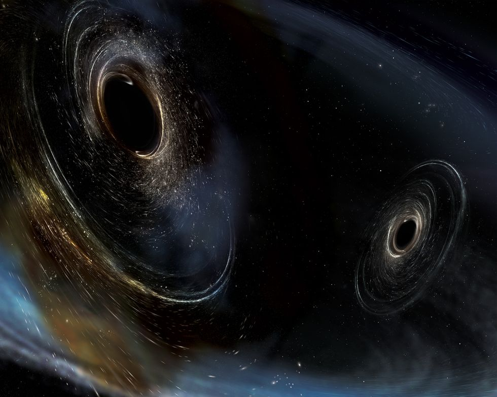 Two black holes sucking each other in.