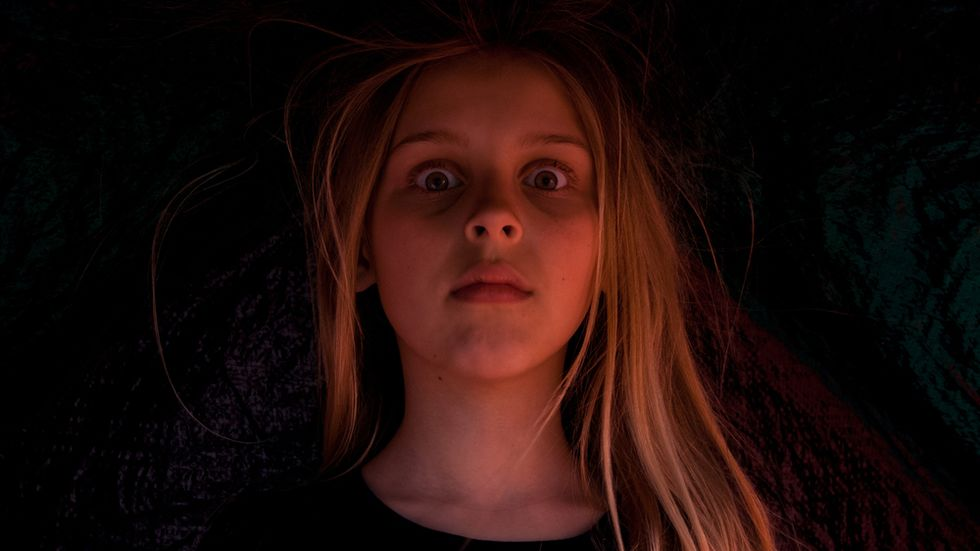 A girl who has just seen a ghost.