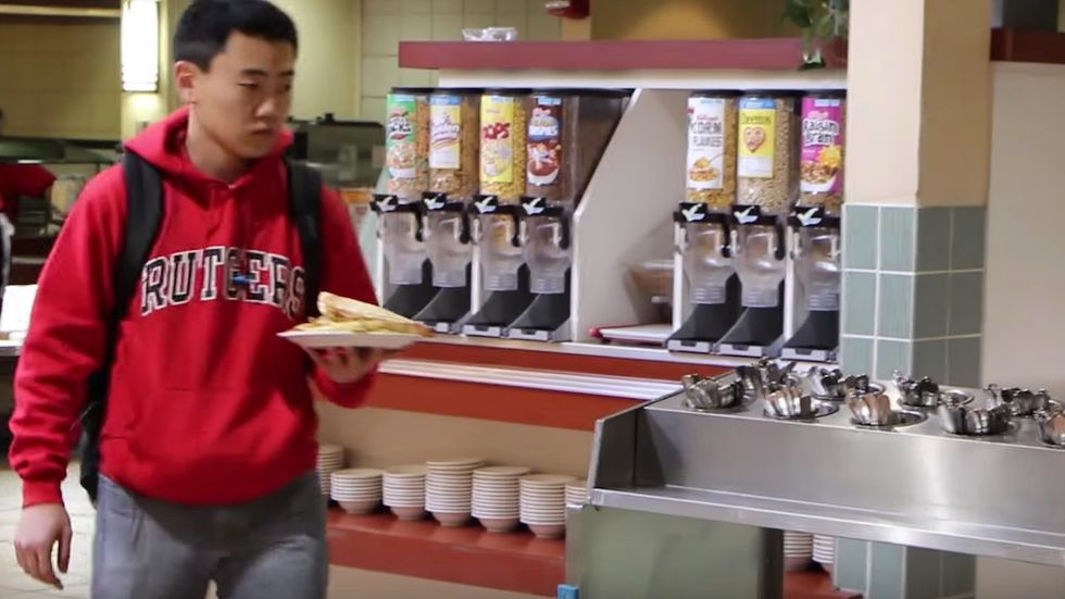 Student getting food at the dining hall