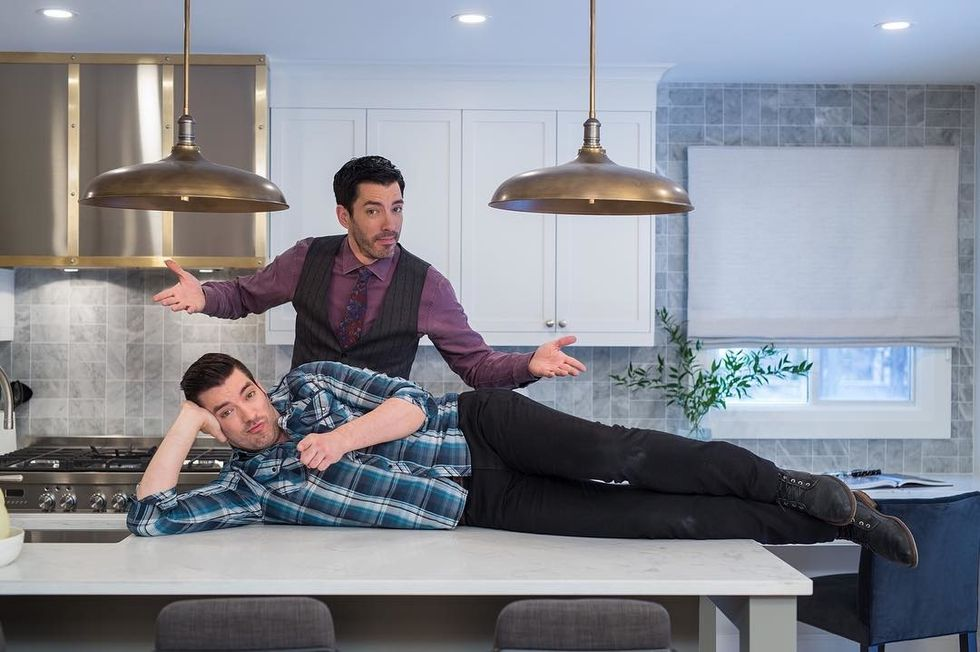 """The """"property brothers"""" posing for a picture"""