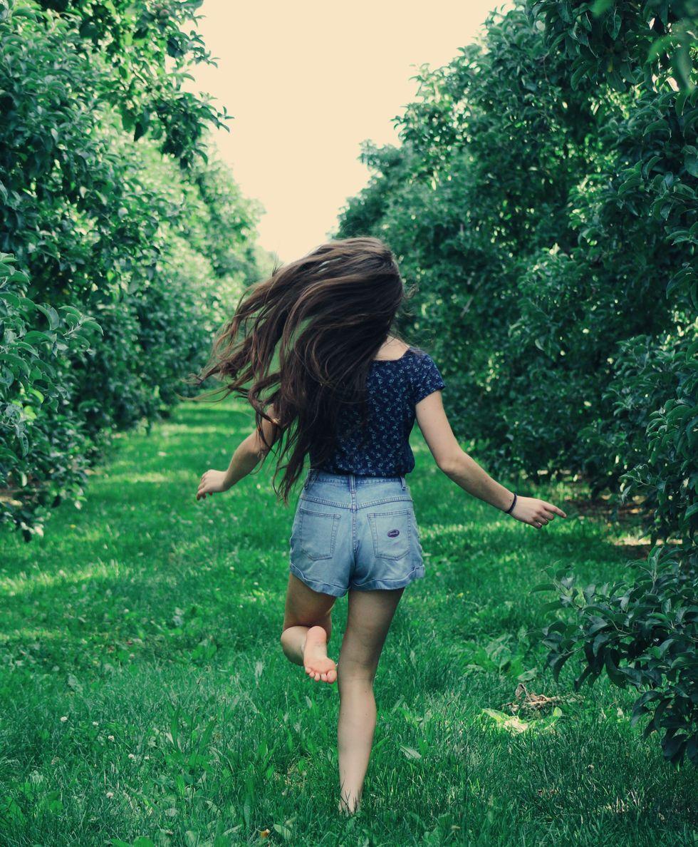 woman running away