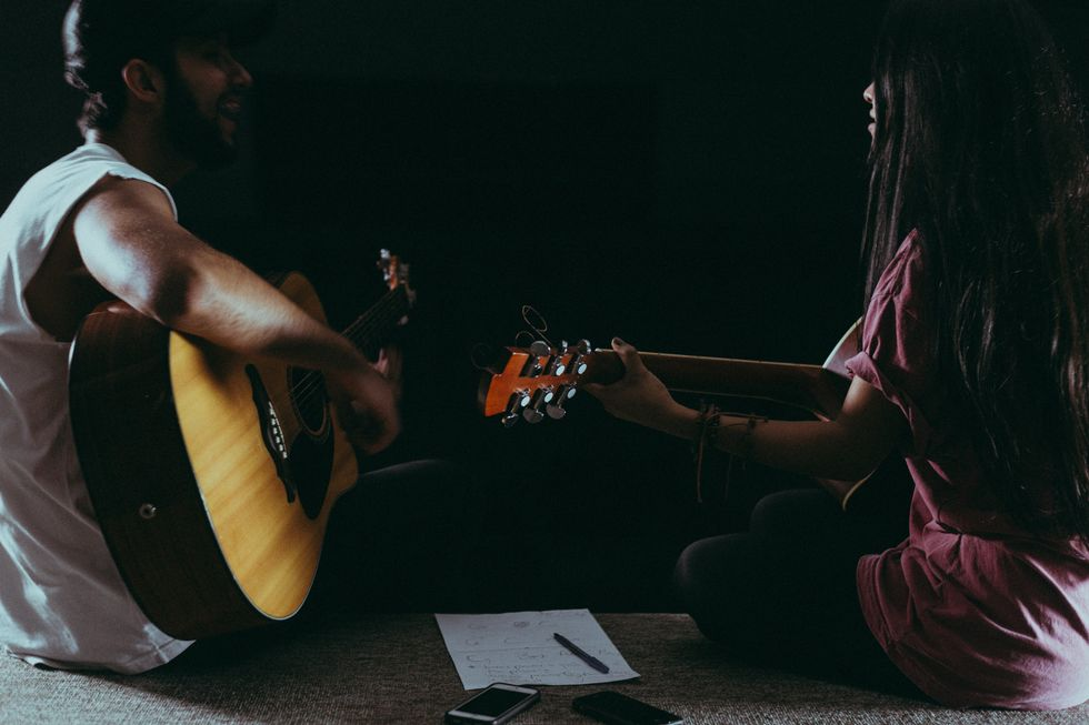 https://www.pexels.com/photo/man-and-woman-playing-guitar-1164763/