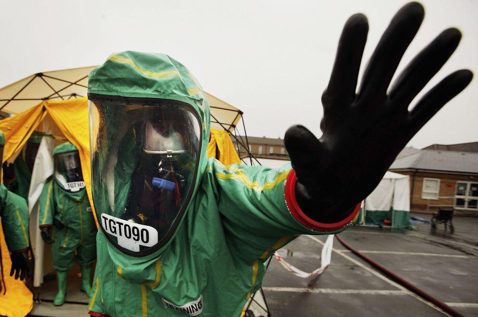 man in contamination suit