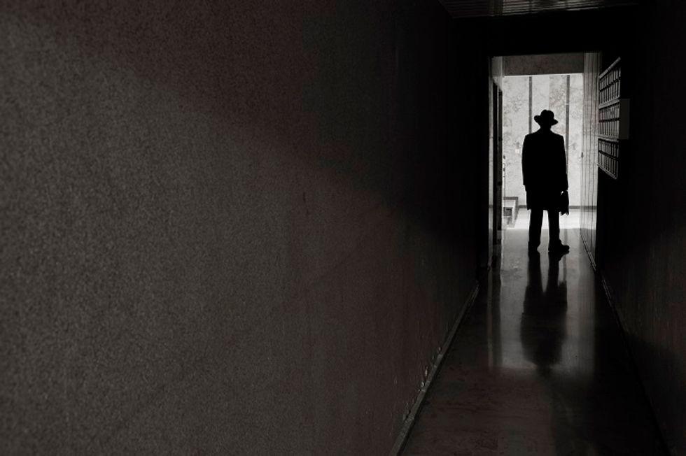 Man in dark hallway