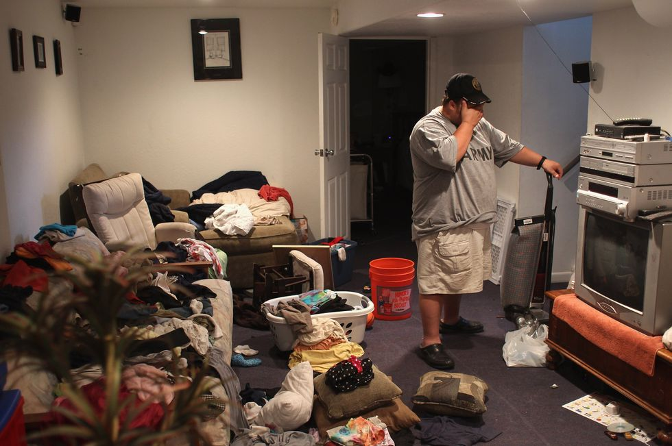 Man with PTSD in messy house.