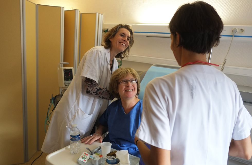 Nurse and doctor cheer a patient up.