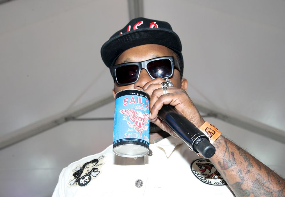 A rap artist drinking a brand of alcohol on stage