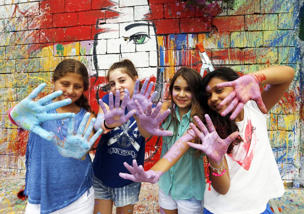 Creative Young Kids with Paint on their Hands