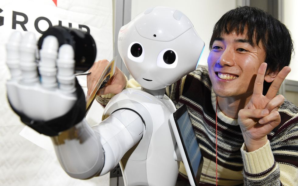 Robot Pepper takes a photo with a human.