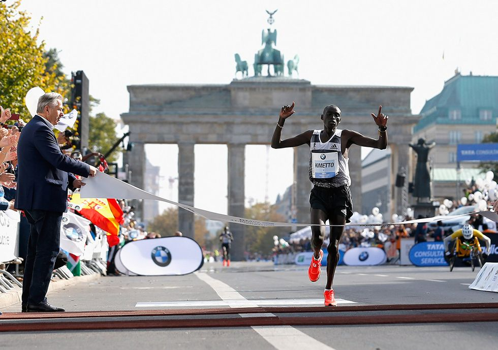 Dennis Kimetto of Kenya crosses a marathon finish line.