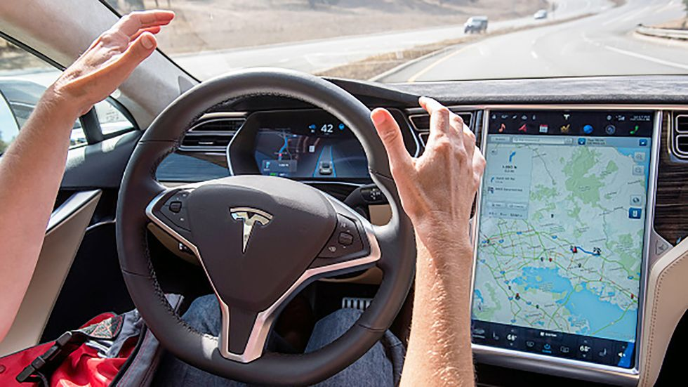 A member of the media test drives a Tesla Motors Inc. Model S car equipped with Autopilot in Palo Alto, California.
