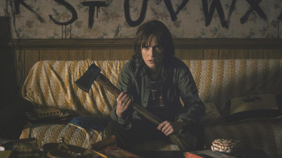 Winona Ryder holding an axe in Stranger Things