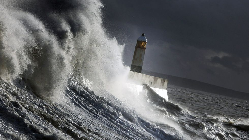 Waves batter the harbour wall on November 22, 2009 in Porthcawl, Wales. (Photo by Matt Cardy/Getty Images)